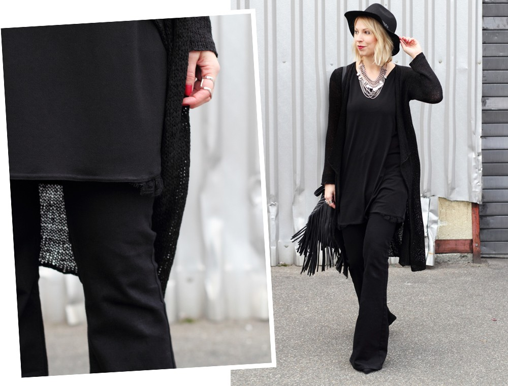 Fashionblogger Karlsruhe Outfit all in black Flared Jeans Cardigan Hut Fransentasche Kleid 3
